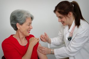 woman avoiding shingles risk in the elderly by receiving a vaccine